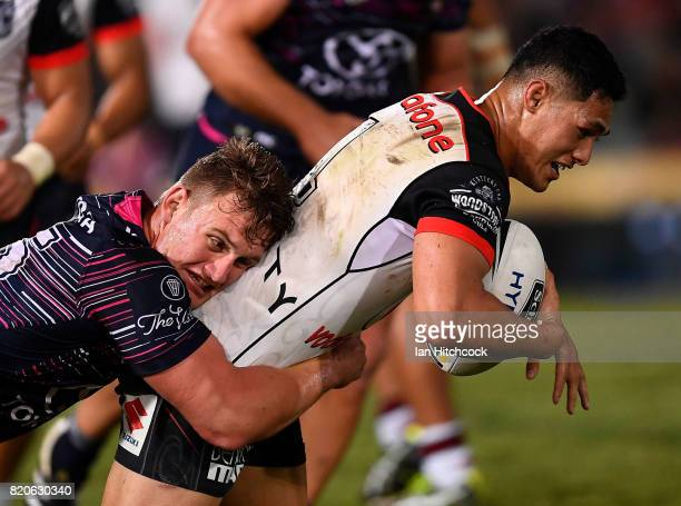 Roger TuivasaSheck of the Warriors is tackled by Coen Hess of the Cowboys during the round 20 NRL match between the North Queensland Cowboys and the...