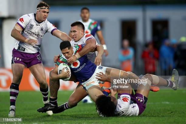 Roger Tuivasa-Sheck of the Warriors is tackled during the round 13 NRL match between the New Zealand Warriors and the Melbourne Storm at Mt Smart...