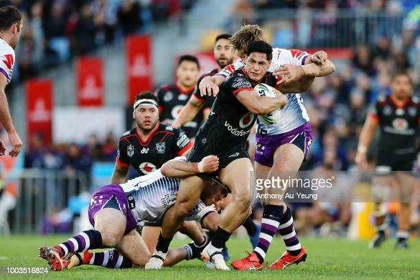Roger TuivasaSheck of the Warriors is tackled during the round 19 NRL match between the New Zealand Warriors and the Melbourne Storm at Mt Smart...