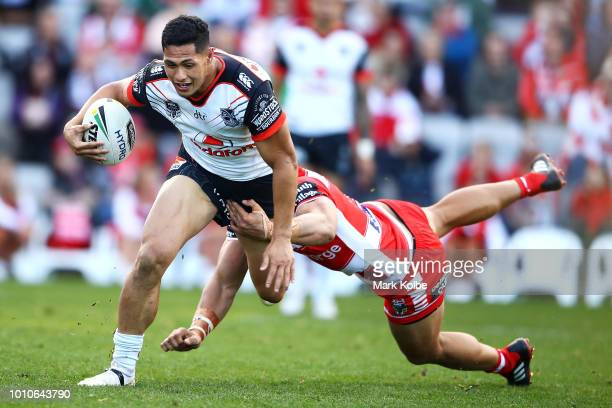 Roger TuivasaSheck of the Warriors is tackled during the round 21 NRL match between the St George Illawarra Dragons and the New Zealand Warriors at...