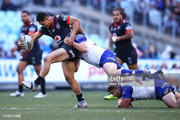 Roger TuivasaSheck of the Warriors is tackled during the round 23 NRL match between the Canterbury Bulldogs and the New Zealand Warriors at ANZ...