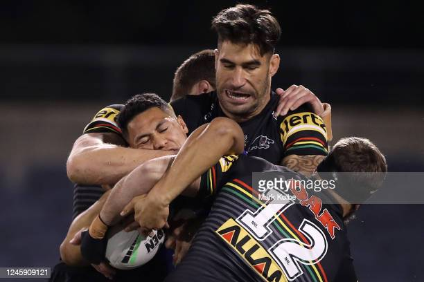 Roger Tuivasa-Sheck of the Warriors is tackled during the round four NRL match between the Penrith Panthers and the New Zealand Warriors at...