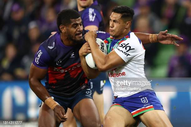 Roger Tuivasa-Sheck of the Warriors is tackled during the round seven NRL match between the Melbourne Storm and the New Zealand Warriors at AAMI Park...