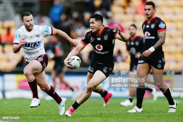 Roger TuivasaSheck of the Warriors makes a run against Blake Green of the Sea Eagles during the round 25 NRL match between the New Zealand Warriors...