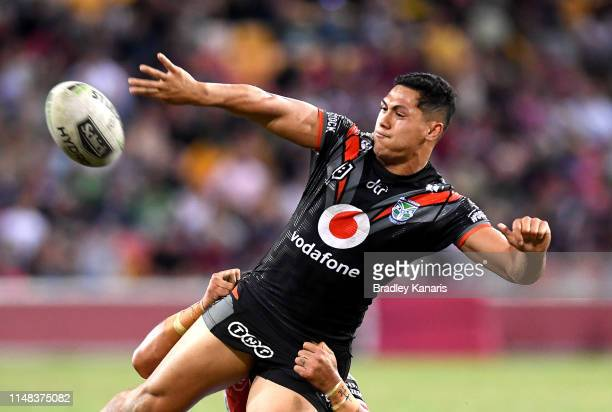 Roger Tuivasa-Sheck of the Warriors offloads during the round nine NRL match between the New Zealand Warriors and the St George Illawarra Dragons at...