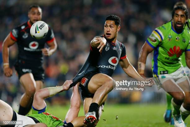 Roger TuivasaSheck of the Warriors offloads in a tackle during the round 25 NRL match between the New Zealand Warriors and the Canberra Raiders at Mt...