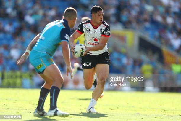 Roger TuivasaSheck of the Warriors passes during the round 20 NRL match between the Gold Coast Titans and the New Zealand Warriors at Cbus Super...