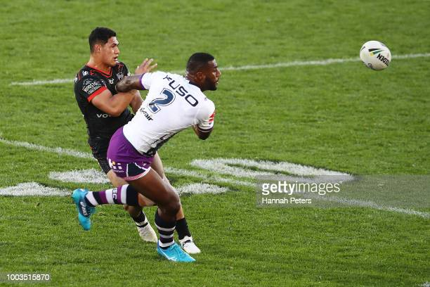 Roger TuivasaSheck of the Warriors passes the ball out during the round 19 NRL match between the New Zealand Warriors and the Melbourne Storm at Mt...