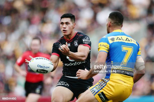 Roger TuivasaSheck of the Warriors with a pass against Corey Norman of the Eels during the round six NRL match between the New Zealand Warriors and...