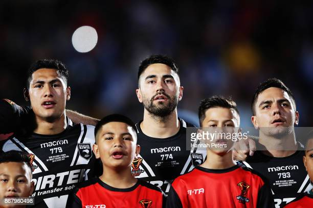 Roger TuivasaSheck Shaun Johnson and Kodi Nikorima of the Kiwis sing the national athem ahead of the 2017 Rugby League World Cup match between the...