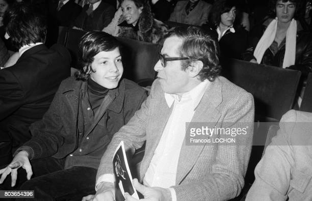 Roger Vadim during the concert of Daniel Guichard at the Olympia in December 1975 in Paris France with him a young boy possibly his stepson Charles...