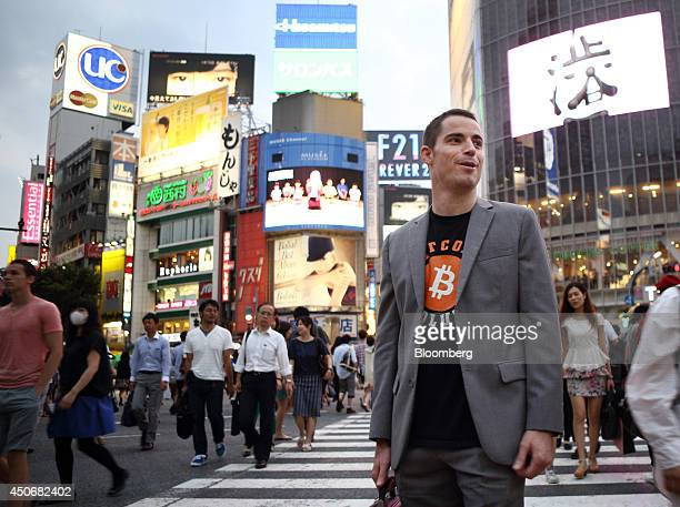 Roger Ver founder of Passports for Bitcoincom poses for a photograph in the Shibuya district of Tokyo Japan on Wednesday June 4 2014 He's known as...