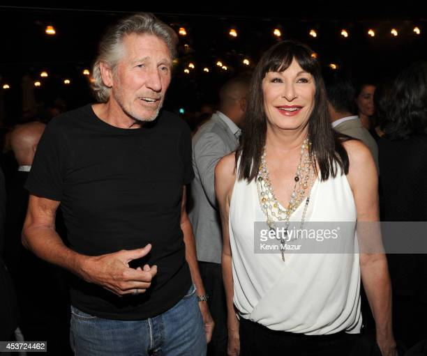 Roger Waters and Anjelica Houston attend Apollo in the Hamptons at The Creeks on August 16 2014 in East Hampton New York