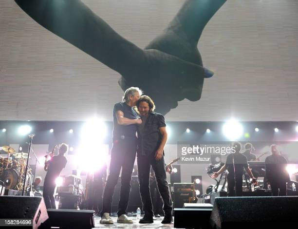 Roger Waters and Eddie Vedder perform at '121212' a concert benefiting The Robin Hood Relief Fund to aid the victims of Hurricane Sandy presented by...