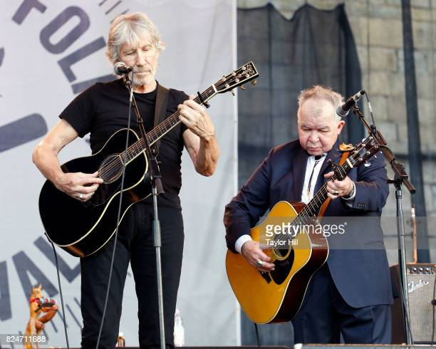Roger Waters and John Prine perform during the 2017 Newport Folk Festival at Fort Adams State Park on July 30 2017 in Newport Rhode Island