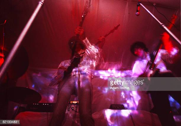 Roger Waters and Syd Barrett of Pink Floyd perform under a psychedelic light show at the Architectural Association student party London 16th December...