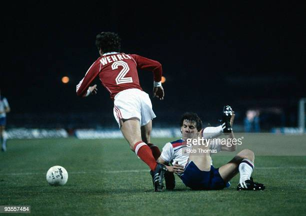 Roger Wehrli of Switzerland moves away from Steve Coppell of England during the England v Switzerland World Cup Qualifying match held at Wembley...