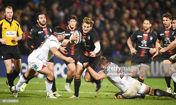 Roger Wilson and Ricky Lutton of Ulster tackle Toby Flood of Toulouse during the European Champions Cup Pool 1 rugby game at Kingspan Stadium on...