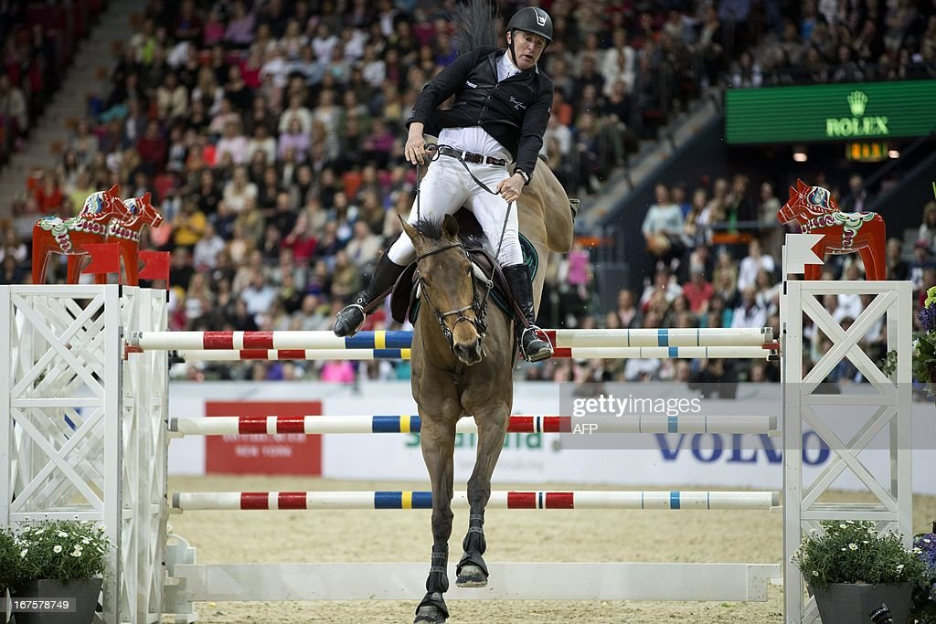 Roger Yves Bost of France rides during the Rolex FEI World Cup Jumping final Friday April 26, 2013 during the Gothenburg Horse Show in Scandinavium.