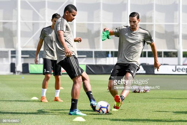 Rogerio and Mattia De Sciglio during a Juventus training session at Juventus Training Center on July 13 2018 in Turin Italy