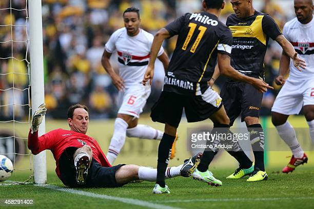 Rogerio Ceni of Sao Paulo defenses the ball during a match between Criciuma and Sao Paulo as part of Campeonato Brasileiro 2014 at Heriberto Hulse...