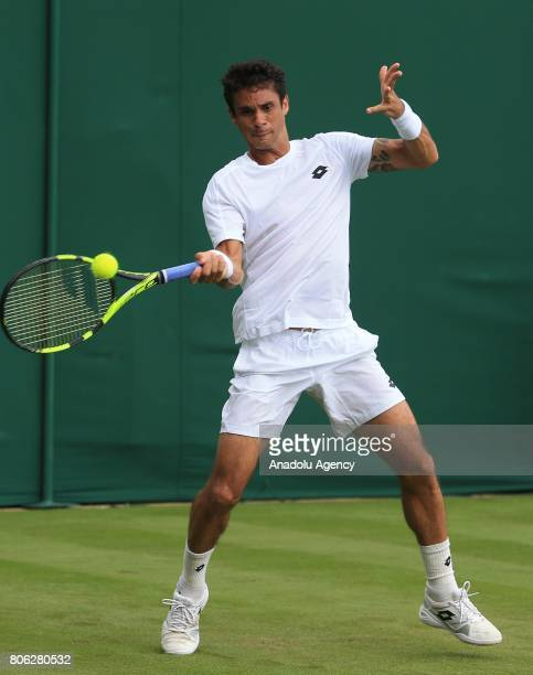 Rogerio Dutra Silva of Brazil in action against Benoit Paire of France on day one of the 2017 Wimbledon Championships at the All England Lawn and...