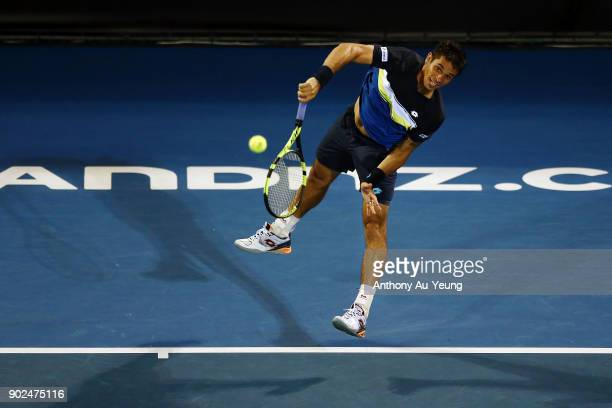 Rogerio Dutra Silva of Brazil serves in his first round match against Denis Shapovalov of Canada during day one of the ASB Men's Classic at ASB...