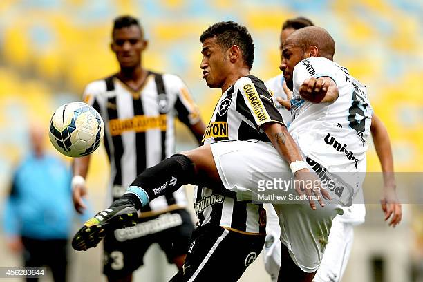 Rogerio of Botafago fights for control of the ball against Fellipe Bastos of Gremio during a match between Botafogo and Gremio as part of Brasileirao...