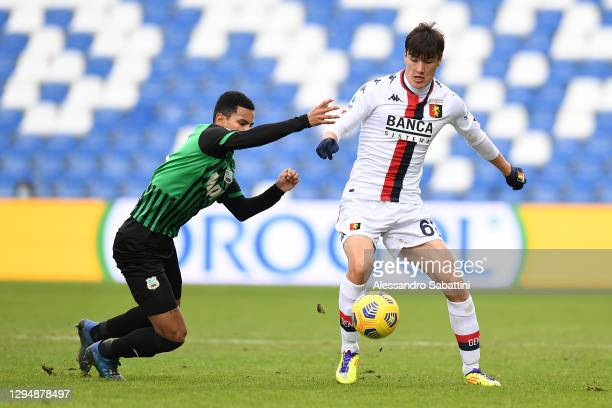 Rogerio of Sassuolo battles for possession with Eldor Shomurodov of Genoa during the Serie A match between US Sassuolo and Genoa CFC at Mapei Stadium...