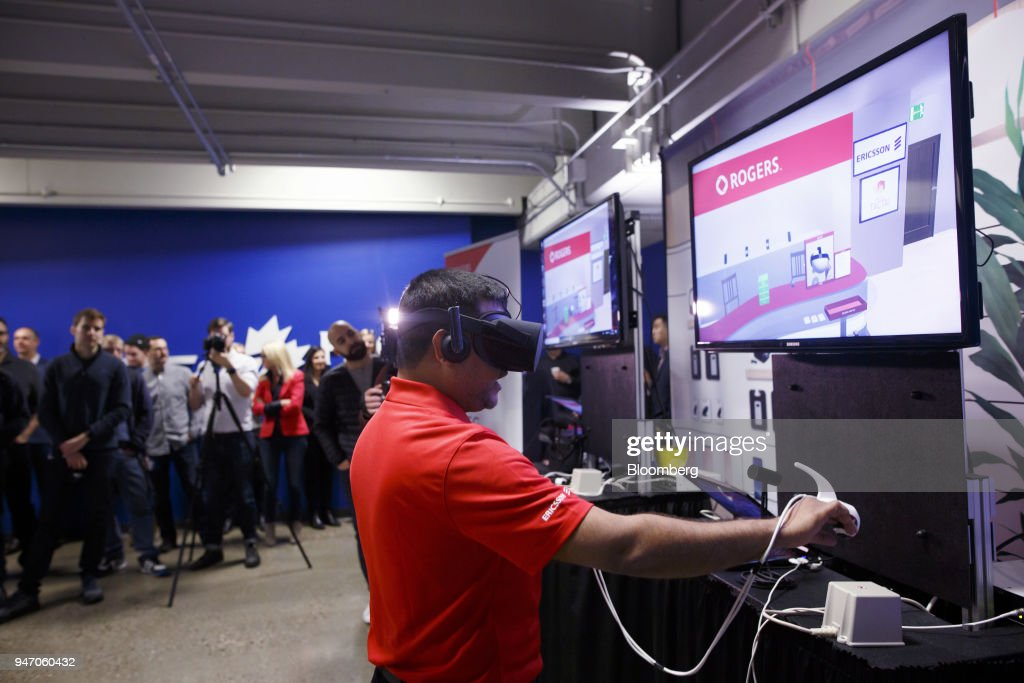 A Rogers Communications Inc. employee uses a virtual reality (VR) headset to shop at a virtual store during a demonstration of 5G wireless network technology in Toronto, Ontario, Canada, on Monday, April 16, 2018. Chief Technology Officer Jorge Fernandes said that 5G networks probably won't to be ready for prime time until about 2020 while hardware and software is developed. Photographer: Cole Burston/Bloomberg via Getty Images