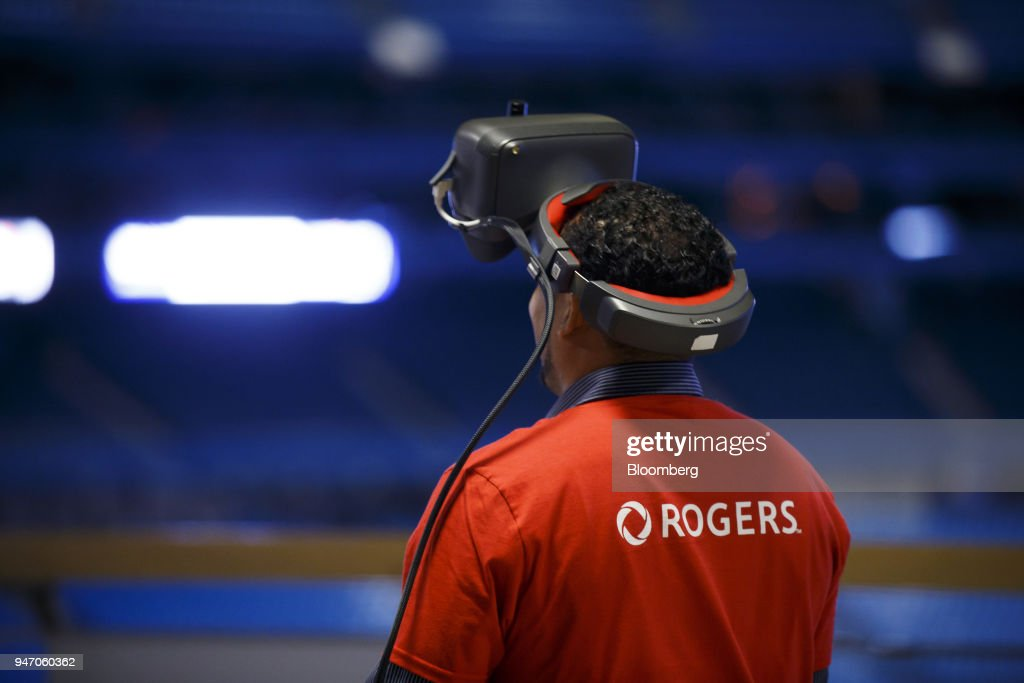 A Rogers Communications Inc. employee wears a virtual reality (VR) headset during a demonstration of 5G wireless network technology in Toronto, Ontario, Canada, on Monday, April 16, 2018. Chief Technology Officer Jorge Fernandes said that 5G networks probably won't to be ready for prime time until about 2020 while hardware and software is developed. Photographer: Cole Burston/Bloomberg via Getty Images