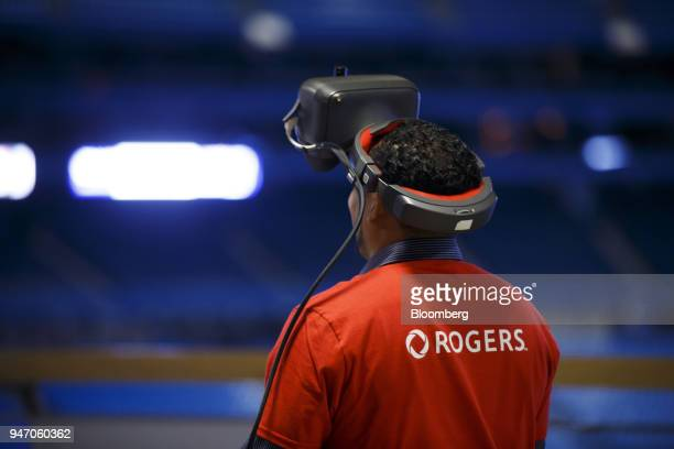 A Rogers Communications Inc employee wears a virtual reality headset during a demonstration of 5G wireless network technology in Toronto Ontario...