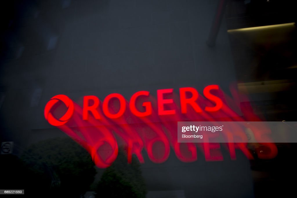 Rogers Communications Inc. signage illuminated at night is seen in this long exposure photograph taken in Toronto, Ontario, Canada, on Wednesday, May 17, 2017. Rogers Communications, Canada's largest wireless carrier, is leveraging organic growth in the country's wireless market to expand its subscriber base. Photographer: Brent Lewin/Bloomberg via Getty Images