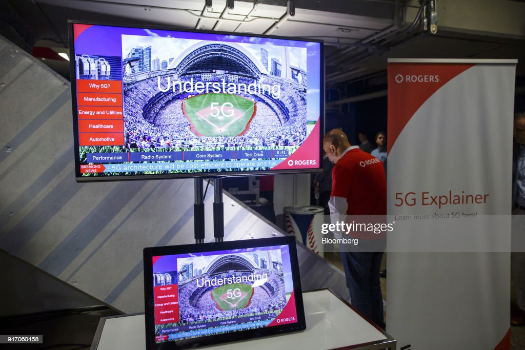 A Rogers Communications Inc. video is displayed on monitors during a demonstration of 5G wireless network technology in Toronto, Ontario, Canada, on Monday, April 16, 2018. Chief Technology Officer Jorge Fernandes said that 5G networks probably won't to be ready for prime time until about 2020 while hardware and software is developed. Photographer: Cole Burston/Bloomberg via Getty Images