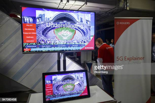 A Rogers Communications Inc video is displayed on monitors during a demonstration of 5G wireless network technology in Toronto Ontario Canada on...