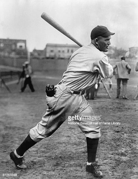 Rogers Hornsby of the Chicago Cubs poses for an action portrait as he swings in Wrigley Field in Chicago Illinois Hornsby played for the Cubs from...