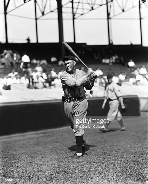 Rogers Hornsby of the Chicago Cubs swinging a bat in 1930