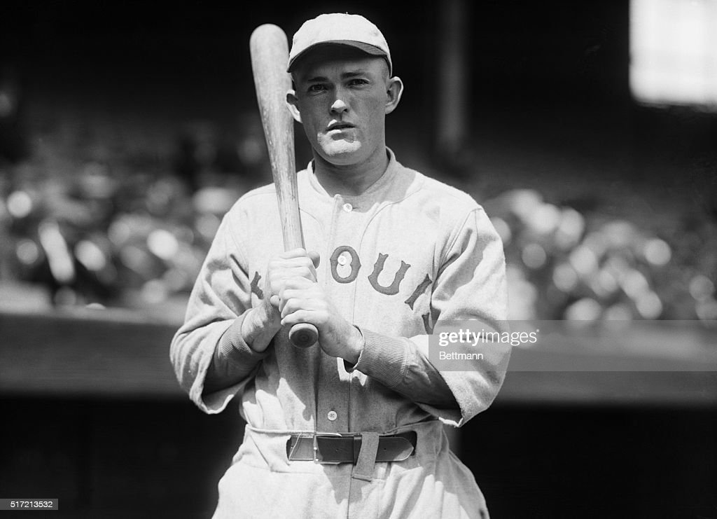 5/12/1921- Rogers Hornsby, star second baseman of the St. Louis Cardinals and batting king of the National League. Hornsby led the league in batting last season with an average of 370. He is out to repeat this year and to better his last seasons mark. Hornsby held this title from 1920-25, and ended his career with the second highest overall average of .359. He also holds the record for highest average in a season at .424. This photograph depicts him holding a bat on his shoulder, alone.