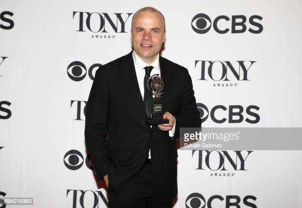 """Rogers, winner of the award for """"Oslo,"""" poses in the press room during the 2017 Tony Awards at 3 West Club on June 11, 2017 in New York City."""