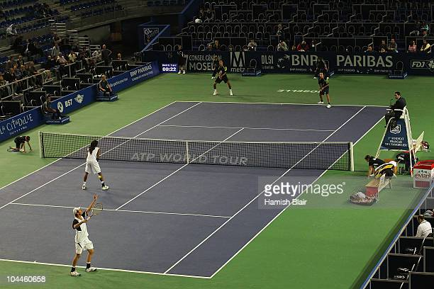 Rogier Wassen of Netherlands serves with team mate Dustin Brown of Jamaica looking on during the doubles final against Marcelo Melo and Bruno Soares...