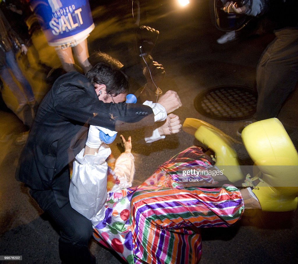 A rogue clown who charged at Condoleezza Rice is taken down by her security detail as she works the crowd along 17th St. NW before the annual High Heel Race on Tuesday night, Oct. 30, 2007.