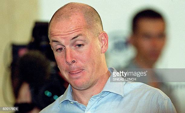 Rogue trader Nick Leeson the man who broke Britain's Barings bank bites his lip as he arrives fior a press conference at the Hilton Hotel near...