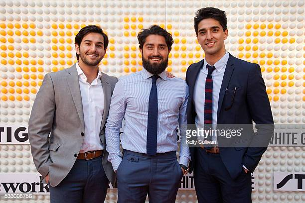Roh Habibi and friends arrive on the orange carpet at the SPiN San Francisco Grand Opening on May 19 2016 in San Francisco California