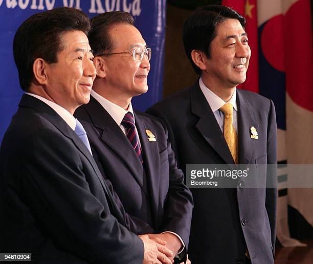 Roh Moohyun president of South Korea left Wen Jiabao prime minister of China center and Shinzo Abe prime minister of Japan right pose for a...