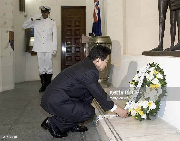 Roh Moohyun President of the Republic of Korea pays his respects to the War dead of the Korean war during a Wreathlaying ceremony at the National War...