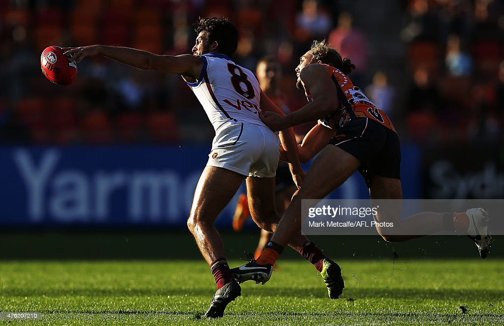 Rohan Bewick of the Lions and Matthew Buntine of the Giants compete for the ball during the round 10 AFL match between the Greater Western Sydney Giants and the Brisbane Lions at Spotless Stadium on June 7, 2015 in Sydney, Australia.