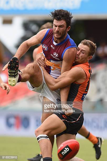 Rohan Bewick of the Lions kicks the ball during the NAB Challenge AFL match between the Brisbane Lions and the Greater Western Sydney Giants at...