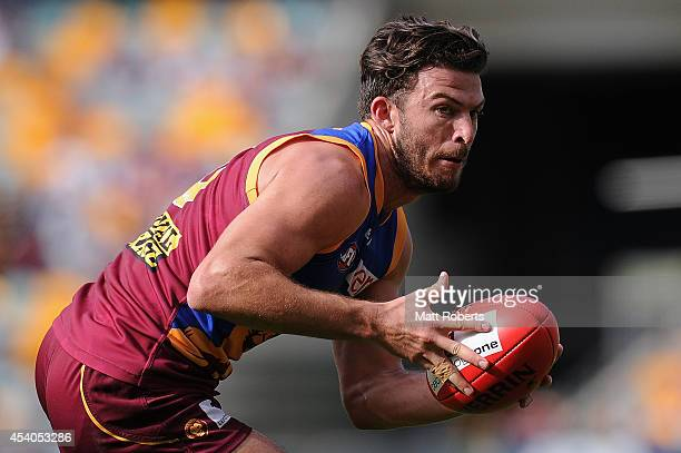 Rohan Bewick of the Lions looks to kick the ball during the round 22 AFL match between the Brisbane Lions and the Fremantle Dockers at The Gabba on...