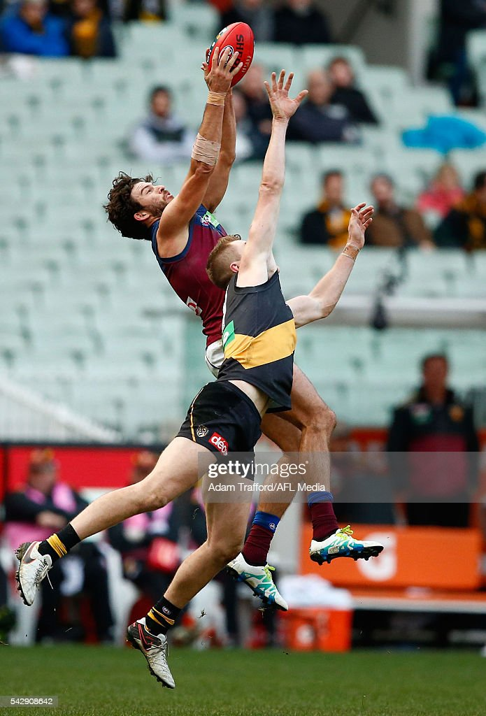 Rohan Bewick of the Lions marks the ball over Jacob Townsend of the Tigers during the 2016 AFL Round 14 match between the Richmond Tigers and the Brisbane Lions at the Melbourne Cricket Ground on June 25, 2016 in Melbourne, Australia.