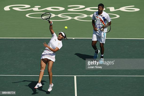 Rohan Bopanna and Sania Mirza of India in action during the mixed doubles bronze medal match against Radek Stepanek and Lucie Hradecka of the Czech...